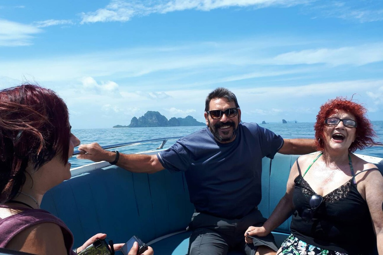 a family group enjoying a trip on a speed boat in tropical krabi